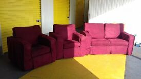 red two seater plus two armchairs