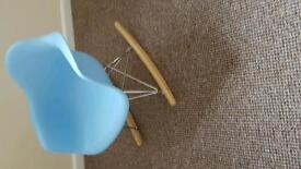 Childrens pale blue plastic rocking chair