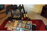 PS3 Console bundle (includes, guitar, drums, microphones, Move equipment and more than 55 games)