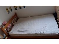 Single wooden bed - spacious with mattress