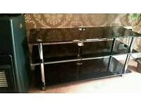 Black glass 3 tier tv stand.fits upto 50 inch tv