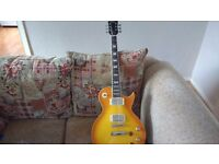 Vintage V100PGM Lemon Drop Reissued Hi Gloss Tobacco Burst