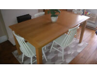 Oak dining table by Morris furniture