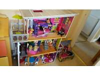 Dolls house and optional box of loads of dolls and outfits etc