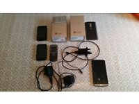 LG G3 with bundle of accessories and 3 other phones