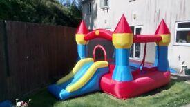 Happyhop bouncy castle with slide