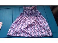 Two pretty purple and coral coloured girls tops aged 5-6 years.