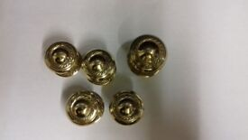 New in wrapping brass door knobs in two sizes