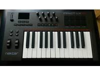 Nektar Impact LX25 Midi Keyboard Controller.