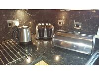 Stainless steel kettle,toaster and bread bin.