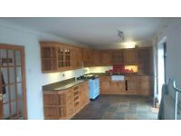 High quality, mid oak 'Loxley' kitchen, with marble worktop