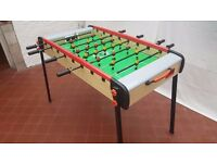 Football table game. Legs fold for easy storage.