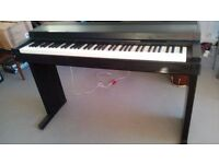 Yamaha Clavinova CLP-100 Electric Piano with 76 Weighted Keys