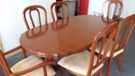 Expandable table and 6 chair including 2 carver chairs