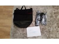 Bugaboo donkey v1.1 includes 2 raincovers, a side basket, bugaboo changing bag and 2 hoods