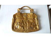 New Billabong Gold and satin lined handbag