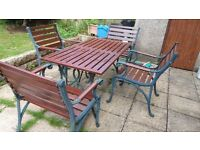 Cast iron rectangular table and four armchairs