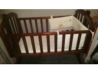 Brand new (opened) unused swinging wooden obaby crib and mattress with bedding