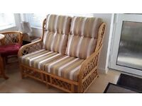 Conservatory cane furniture, two seater sofa and two chairs also table and two chairs