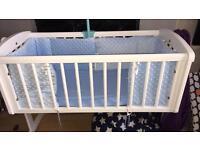 White swing crib and bedding