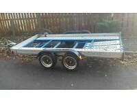Tilting car transport trailer