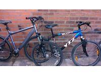 2 mens mountain bikes with 26 inch wheels saracen and scott sracen disc brakes