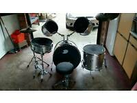 Full set of drums including stool and matts