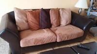 leather and microfibre couch and love seat