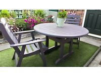 Garden table and two chairs in lavender, solid and sturdy in great condition.