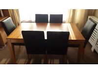 Oak Veneer Dining Table and 6 Black Faux Leather Chairs