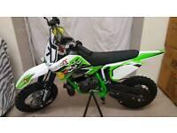 Green IMR racing..... 50cc kids mx bikes....... ktm 9hp engine..