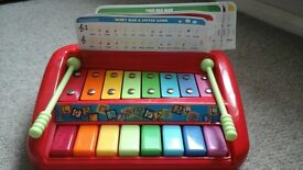 toy xylophone piano and jungle junction hippo bus