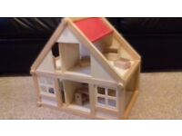 Wooden dolls house with furniture (see photos).