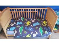Cot bed with mattress and mattress protector.