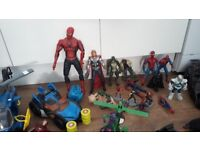 Super hereo figures and helicopter and two bat man cars .and smaller super hero figures