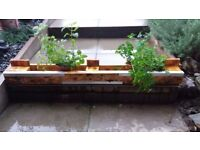 HEAVY Wooden Handmade Decorative Pallet Planter with metal detailing and fake grass lining.