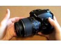 D3100 DSLR Nikon with lens, bag and memory card.