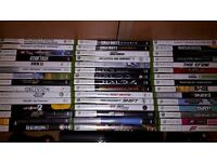 Xbox 360 E with 4 Controllers and 45 Games
