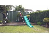 TP climbing frame with swings and slide.