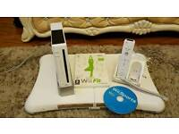 Wii console with controller, wii board and 2 games