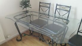 glass and metal dining table with 4 leather top chairs