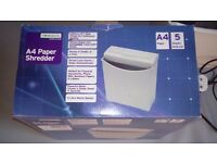 Homebase paper Shredder. Still in box , tested and works quietly and fine, as it should.