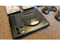 Near Mint Condition Sega Megadrive. Boxed with 2 controllers and Games. Fully working. Very Rare.