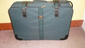 Large Green Carrylite suitcase with built in corner wheels