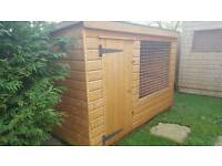 Dog kennel with secure run