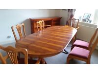 Beautiful yew wood dining table and 6 chairs plus matching sideboard