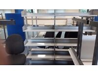 Large quantity of metal shelving double sided