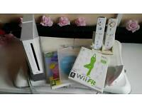 Wii console and Wii fit board with games.