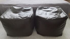 Brown leather poufs