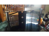Black glass and chrome trim tv stand